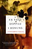 Cover for En tagg doppad i honung